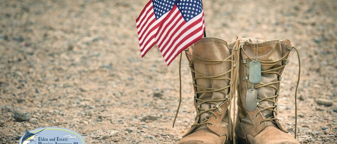 power of attorney lawyer - Army boots with two American flags and dog tags