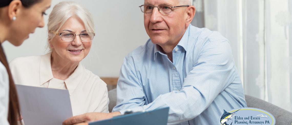 estate planning lawyer - elder couple meeting with a professional - estate planning lawyer