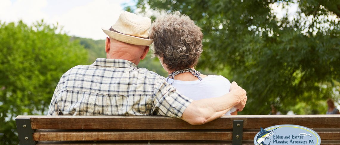 trust and estate attorneys in florida - Mature couple sitting on a bench